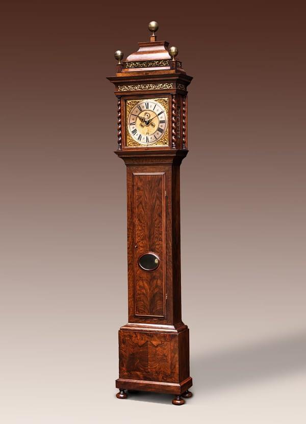 Amsterdams staand horloge Staand horloge in een met notenhout gefineerde kast. Gesigneerd Sijmon van Leeuwen, Amsterdam.